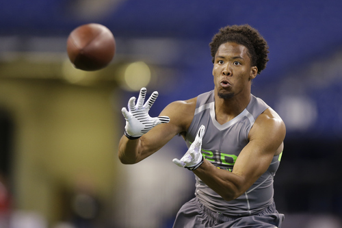 Virginia Tech defensive back Kyle Fuller runs a drill at the NFL football scouting combine in Indianapolis, Tuesday, Feb. 25, 2014. (AP Photo/Michael Conroy)