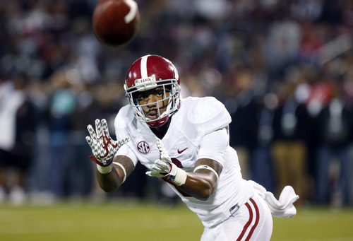 Alabama defensive back Ha Ha Clinton-Dix (6) catches a pass during pre-game warmups prior to the start an NCAA college football game against Mississippi State, Saturday, Nov. 16, 2013, in Starkville, Miss. Alabama won 20-7. (AP Photo/Rogelio Solis)