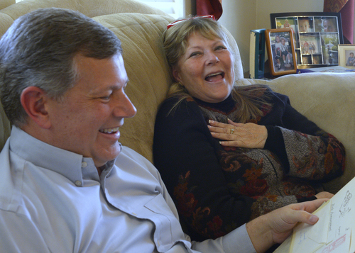 Rick Egan  | The Salt Lake Tribune   Ken Drake shares a laugh with his birth mother Raella Bodinus, while meeting her  for the first time, at his home in Lindon,  Friday, March 7, 2014. Drake was born in Los Angeles in 1964. He and his birth mother found each other through a DNA match on ancestry.com.