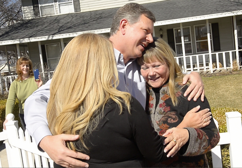 Rick Egan  | The Salt Lake Tribune   Ken Drake hugs his birth mother Raella  Bodinus  (right) and his sister Robin Ramirez (left) for the first time, at his home in Lindon,  Friday, March 7, 2014. Drake was born in Los Angeles in 1964. He and his birth mother found each other through a DNA match on ancestry.com.