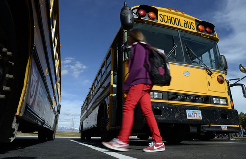 Francisco Kjolseth  |  The Salt Lake Tribune Kids get ready to head home as they load onto their school buses at Sunset Ridge Middle school in West Jordan on Monday, March 3, 2014. Out of 21 buses that pulled up, three ran on compressed natural gas. The Jordan District has more CNG buses than any other in the state.