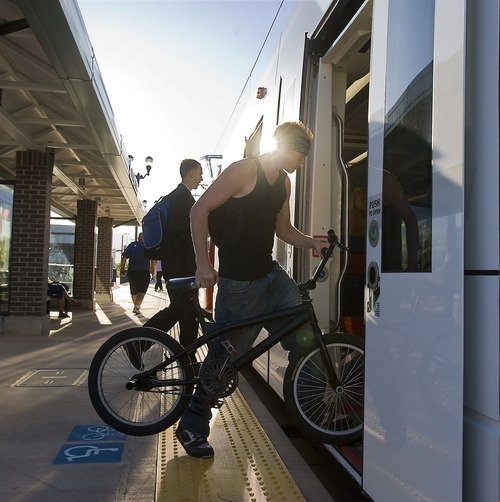 Al Hartmann  |  Tribune file photo Passengers board an early morning TRAX train at West Valley Central Station.