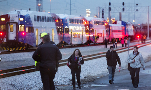 Steve Griffin  |  The Salt Lake Tribune   Passengers on a FrontRunner train that struck a truck stopped on the tracks at an intersection at 1800 N. and Warm Springs Road in Salt Lake City, Utah are allowed to walk away from the train Thursday, February 13, 2014. Many of the 300 passengers were loaded on UTA busses that took them to their destination. Others arranged their own transportation from the scene. The train was headed from Salt Lake City to Ogden, Utah. The driver of the truck was taken to a local hospital and according to authorities is listed in stable condition.
