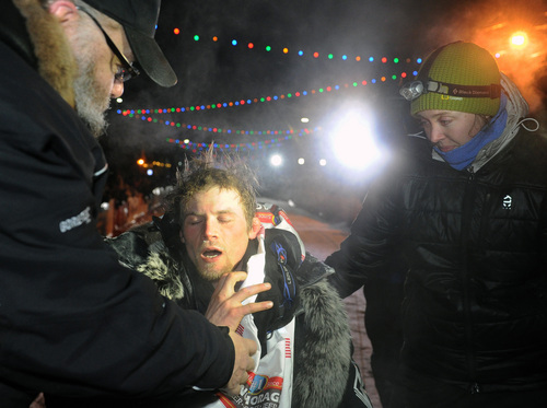 Dallas Seavey, center, reacts after winning the 2014 Iditarod Trail Sled Dog Race in Nome, Alaska, Tuesday, March 11, 2014.  (AP Photo/The Anchorage Daily News, Bob Hallinen)  LOCAL TV OUT (KTUU-TV, KTVA-TV) LOCAL PRINT OUT (THE ANCHORAGE PRESS, THE ALASKA DISPATCH)