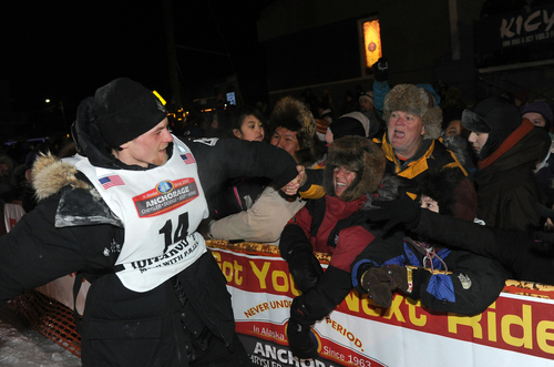 Dallas Seavey is greeted by fans after winning the 2014 Iditarod Trail Sled Dog Race in Nome, Alaska, Tuesday, March 11, 2014.  (AP Photo/The Anchorage Daily News, Bob Hallinen)  LOCAL TV OUT (KTUU-TV, KTVA-TV) LOCAL PRINT OUT (THE ANCHORAGE PRESS, THE ALASKA DISPATCH)