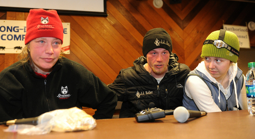 Second placed Aliy Zirkle, left, sits beside winner Dallas Seavey and his wife, Jen, at the Iditarod headquarters, after finishing the 2014 Iditarod Trail Sled Dog Race in Nome, Alaska, Tuesday, March 11, 2014.  (AP Photo/The Anchorage Daily News, Bob Hallinen)  LOCAL TV OUT (KTUU-TV, KTVA-TV) LOCAL PRINT OUT (THE ANCHORAGE PRESS, THE ALASKA DISPATCH)