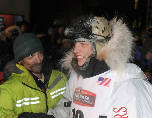Four time Iditarod champion Lance Mackey, left, greets Aliy Zirkle after Zirkle finished in second place behind race winner Dallas Seavey in the 2014 Iditarod Trail Sled Dog Race in Nome, Alaska, Tuesday, March 11, 2014. (AP Photo/The Anchorage Daily News, Bob Hallinen)  LOCAL TV OUT (KTUU-TV, KTVA-TV) LOCAL PRINT OUT (THE ANCHORAGE PRESS, THE ALASKA DISPATCH)