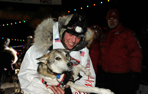 Aliy Zirkle holds her lead dog after finishing in second place behind race winner Dallas Seavey in the 2014 Iditarod Trail Sled Dog Race, Tuesday, March 11, 2014 in Nome, Alaska.  (AP Photo/The Anchorage Daily News, Bob Hallinen)  LOCAL TV OUT (KTUU-TV, KTVA-TV) LOCAL PRINT OUT (THE ANCHORAGE PRESS, THE ALASKA DISPATCH)