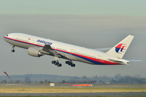 This photo provided by Laurent Errera taken Dec. 26, 2011, shows the Malaysia Airlines Boeing 777-200ER that disappeared from air traffic control screens Saturday, taking off from Roissy-Charles de Gaulle Airport in France. The Malaysia Airlines Boeing 777-200 carrying 239 people lost contact with air traffic control early Saturday morning, March 8, 2014 on a flight from Kuala Lumpur to Beijing, and international aviation authorities still hadn't located the jetliner several hours later. (AP Photo/Laurent Errera)