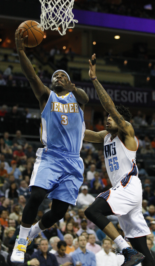 Denver Nuggets guard Ty Lawson, left, drives for a lay up past Charlotte Bobcats guard Chris Douglas-Roberts during the second half of an NBA basketball game in Charlotte, N.C., Monday, March 10, 2014. Charlotte won 105-98. (AP Photo/Nell Redmond)