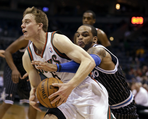 Milwaukee Bucks' Nate Wolters, left, drives against Orlando Magic's Jameer Nelson during the second half of an NBA basketball game, Monday, March 10, 2014, in Milwaukee. (AP Photo/Jeffrey Phelps)