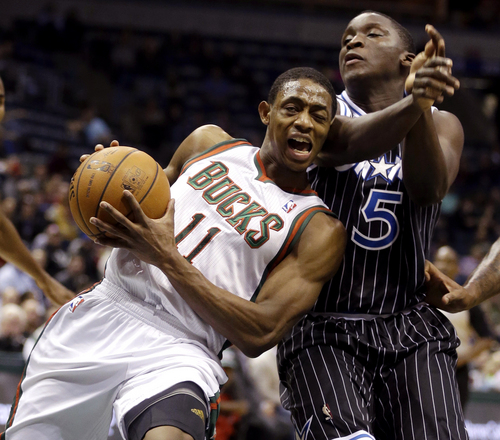 Milwaukee Bucks' Brandon Knight (11) drives against Orlando Magic's Victor Oladipo (5) during the second half of an NBA basketball game, Monday, March 10, 2014, in Milwaukee. (AP Photo/Jeffrey Phelps)
