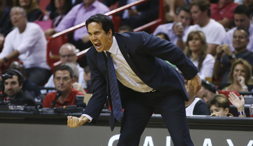Miami Heat coach Erik Spoelstra reacts after his team was charged with an offensive foul against the Washington Wizards during the second half of an NBA basketball game in Miami, Monday, March 10, 2014. The Heat won 99-90. (AP Photo/J Pat Carter)