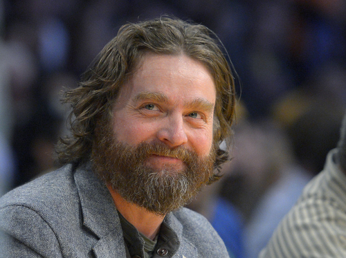"""FILE - In this Feb. 28, 2013 file photo, actor Zach Galifianakis watches the Los Angeles Lakers play the Minnesota Timberwolves in their NBA basketball game in Los Angeles. President Barack Obama is hamming it up online to promote his health care plan. Obama joked Tuesday with Galifianakis, including poking fun at the poorly reviewed """"Hangover Part III"""" during an interview on thhe website Funny or Die.  (AP Photo/Mark J. Terrill, File)"""