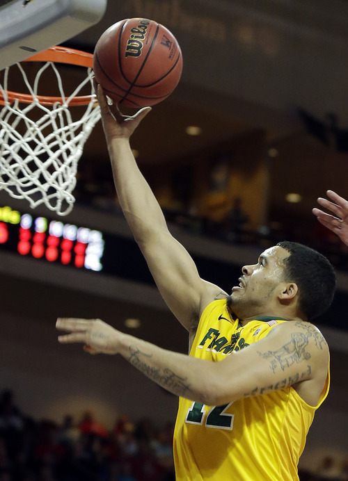 San Francisco's Avry Holmes shoots during the first half of a West Coast Conference tournament NCAA college basketball game against BYU Monday, March 10, 2014, in Las Vegas. (AP Photo/Isaac Brekken)