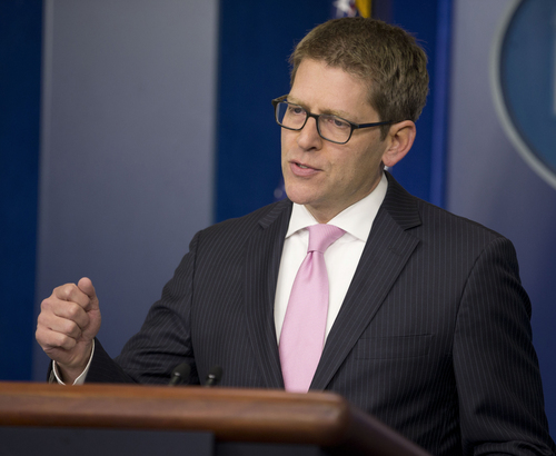 In this March 10, 2014, photo, White House press secretary Jay Carney answers questions during his daily news briefing at the White House as he spoke about the situation in Ukraine. In a diplomatic dig at Russia, President Barack Obama is hosting the new Ukrainian prime minister at the White House on March 12, a high-profile gesture aimed at cementing the West's allegiance to Ukraine's fledgling government. The meeting between Obama and Prime Minister Arseniy Yatsenyuk comes as a pro-Russian area of Ukraine readies for a referendum Sunday to determine its future.  (AP Photo/Pablo Martinez Monsivais)