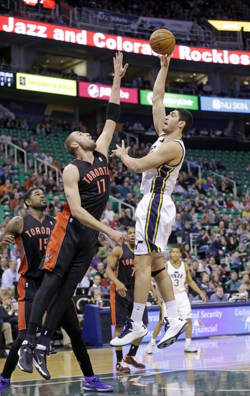 Utah Jazz's Enes Kanter (0), of Turkey, shoots as Toronto Raptors' Jonas Valanciunas (17), of Lithuania, defends in the first quarter of an NBA basketball game Monday, Feb. 3, 2014, in Salt Lake City.  (AP Photo/Rick Bowmer)