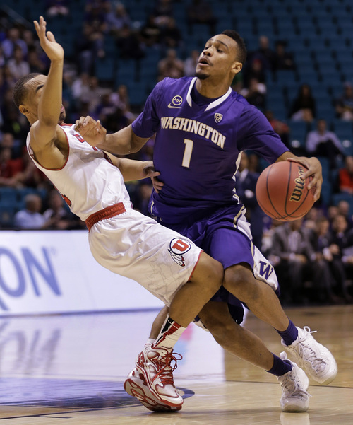 Washington's Darin Johnson (1) drives against Utah's Brandon Taylor in the first half of an NCAA Pac 12 conference tournament college basketball game, Wednesday, March 12, 2014, in Las Vegas. (AP Photo/Julie Jacobson)