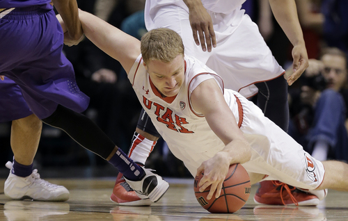 Utah's Jeremy Olsen dives for a loose ball against Washington in the first half of an NCAA Pac 12 conference tournament college basketball game, Wednesday, March 12, 2014, in Las Vegas. (AP Photo/Julie Jacobson)