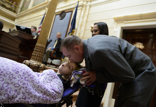 Francisco Kjolseth  |  The Salt Lake Tribune Catrina and Jeff Nelson alongside their daughter, Charlee, 6, who suffers from Late Infant Batten Disease, a terminal inherited disorder of the nervous system. The family was acknowledged on the Senate floor at the Utah Capitol after senators unanimously passed HB105,which would provide access to cannabis oil for epileptic kids, on Tuesday, March 11, 2014.