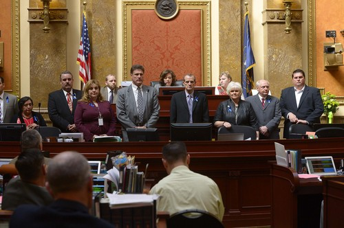 Leah Hogsten     The Salt Lake Tribune Rep. Jim Dunnigan, R-Taylorsville, chairman of the investigative committee, and fellow legislators on the committee present their final report, Wednesday, March, 12, 2014, to the Utah House, into former Attorney General John Swallow.  A stack of more than 200 pages with 3,700 exhibits was submitted as the result of a four-month, $4 million investigation, which contributed to Swallow's resignation.