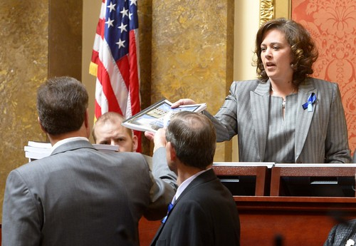 Leah Hogsten     The Salt Lake Tribune Rep. Jim Dunnigan, R-Taylorsville, chairman of the investigative committee, and fellow legislators on the committee present their final report, Wednesday, March, 12, 2014, to the Utah House, and Speaker of the House Becky Lockhart (right) into former Attorney General John Swallow.  A stack of more than 200 pages with 3,700 exhibits was submitted as the result of a four-month, $4 million investigation, which contributed to Swallow's resignation.