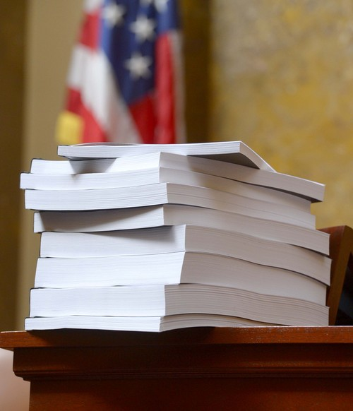 Leah Hogsten     The Salt Lake Tribune The final report, Wednesday, March, 12, 2014, presented to the Utah House, into former Attorney General John Swallow.  A stack of more than 200 pages with 3,700 exhibits was submitted as the result of a four-month, $4 million investigation, which contributed to Swallowís resignation.