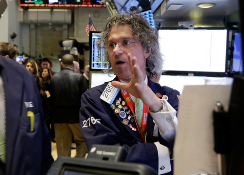 Specialist Donald Civitanova work on the floor of the New York Stock Exchange Wednesday, March 12, 2014. World stock markets were muted Thursday March 13, 2014 as concerns resurfaced about China's economy after lackluster factory production and other data.  (AP Photo/Richard Drew)