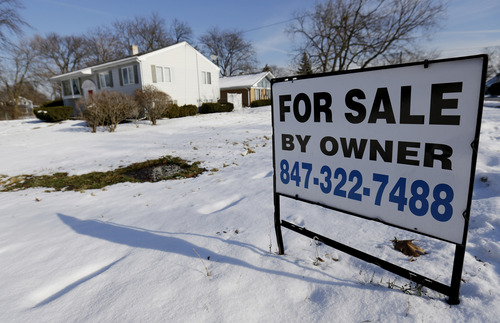 In this Friday, Dec. 27, 2013, file photo, a home is for sale in Glenview, Ill.   Freddie Mac reports on changes in average fixed mortgage rates for the first week of March 2014 on Thursday, March 13, 2014. (AP Photo/Nam Y. Huh, File)
