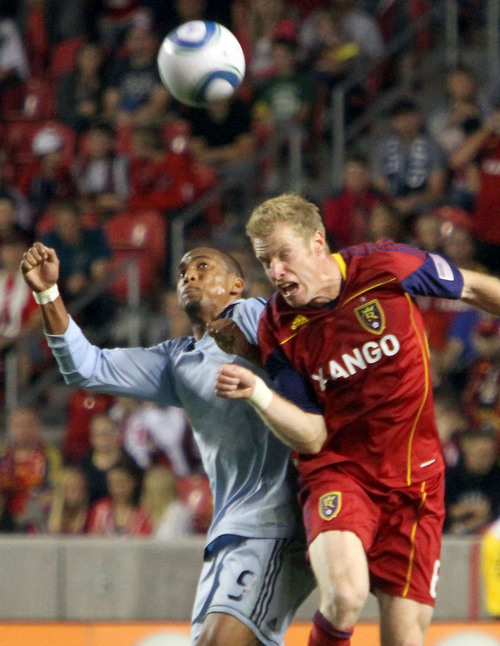 Real Salt Lake defender Nat Borchers, right, fights Sporting Kansas City forward Teal Bunbury for the ball in the first half at Rio Tinto Stadium. Stephen Holt/ Special to the Tribune
