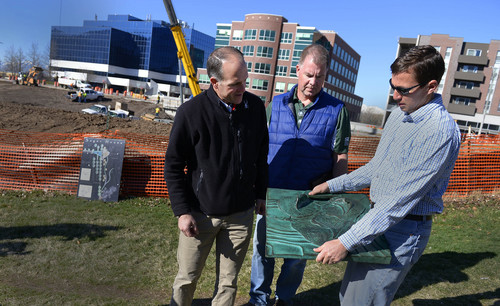 """Leah Hogsten     The Salt Lake Tribune l-r Landscape architect Steven Gilbert, Project manager Walt Gilmore and Juan Arce-Larreta with (PRATT) discuss The Draw, Thursday, March, 13, 2014. The Draw at Sugar House Park will link a """"Sego Lily"""" sculptured dam with flood walls and a spillway that ties together Sugarhouse Commons with Sugar House Park. The north petal of the Sego Lily, which has 30-foot high walls, tips over to become an overlook; the south petal forms a bus shelter; and a parapet along the highway offers a view of the plaza and entrance to the pedestrian crossing below."""