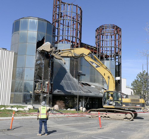 Al Hartmann  |  The Salt Lake Tribune After more than 30 years the iconic glass towers of the 49th Street Galleria at 4998 South 360 West just west of I-15 are demolished with a backhoe Thursday March 13.  The new American International School of Utah, a charter school, will be built on the site.