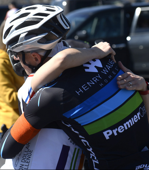 Rick Egan  |  The Salt Lake Tribune Sean Jager hugs one of the participants in the memorial ride for Bryan Byrge and John Coons on Friday.