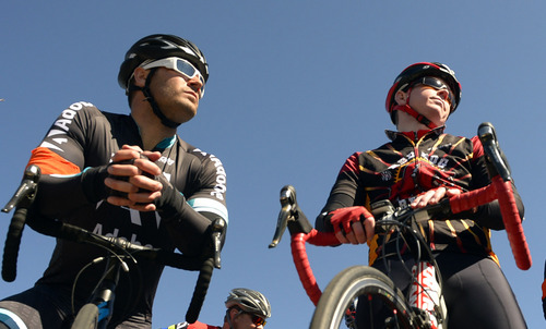 Rick Egan  | The Salt Lake Tribune   Marhsall Stanclift (left) and Rand Blair (right) gather with more than 150 other cyclist for a memorial ride for Bryan Byrge and John Coons, in South Jordan, Friday, March 14, 2014.