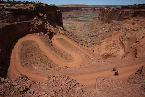 Francisco Kjolseth  |  The Salt Lake Tribune Mountain bikers on the White Rim Trail in Canyonlands National Park in May 2013. A National Park Service report shows Utah's efforts to open nine units during the federal government shutdown paid off with visitors spending $10 for every $1 the state spent for the opening.