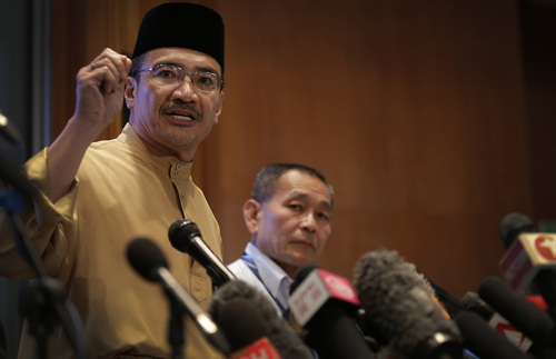Malaysia's Minister of Transport Hishamuddin Hussein, left and Malaysia Airlines Group CEO Ahmad Jauhari Yahya, right, answers queries from the media during a press conference regarding missing Malaysia Airlines jetliner MH370, Friday, March 14, 2014 in Sepang, Malaysia. The international search for the missing Malaysian jetliner expanded westward Friday toward the Indian Ocean amid signs the aircraft may have flown on for hours after its last contact with air-traffic control nearly a week ago. (AP Photo/Wong Maye-E)