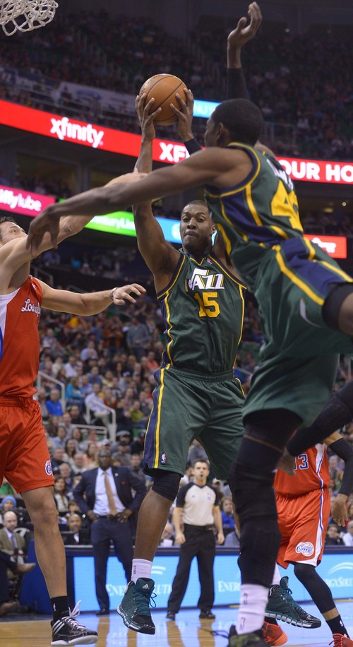 Leah Hogsten     The Salt Lake Tribune Utah Jazz center Derrick Favors (15) pulls down the rebound. Utah Jazz lead the Los Angeles Clippers 51-43 at the half during their game, Friday, March, 14, 2014 at Energy Solutions Arena.