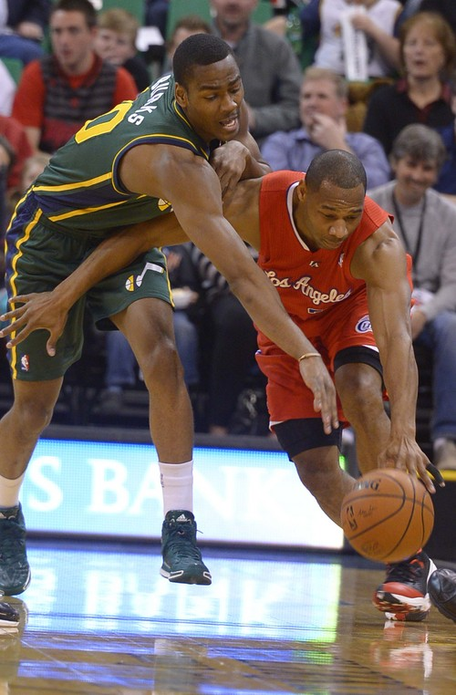 Leah Hogsten     The Salt Lake Tribune Utah Jazz guard Alec Burks (10) battles Los Angeles Clippers guard Willie Green (34) for possession. Utah Jazz lead the Los Angeles Clippers 51-43 at the half during their game, Friday, March, 14, 2014 at Energy Solutions Arena.