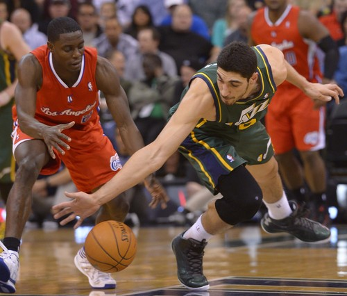 Leah Hogsten     The Salt Lake Tribune Utah Jazz center Enes Kanter (0) hits the deck fighting for a ball with Los Angeles Clippers guard Darren Collison (2). Utah Jazz lead the Los Angeles Clippers 51-43 at the half during their game, Friday, March, 14, 2014 at Energy Solutions Arena.