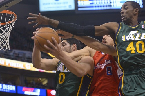 Leah Hogsten     The Salt Lake Tribune l-r Utah Jazz center Enes Kanter (0), Los Angeles Clippers forward Hedo Turkoglu (8) and Utah Jazz forward Jeremy Evans (40) fight for the rebound. Utah Jazz lead the Los Angeles Clippers 51-43 at the half during their game, Friday, March, 14, 2014 at Energy Solutions Arena.