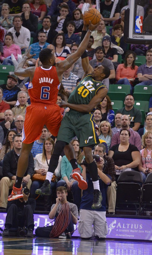 Leah Hogsten     The Salt Lake Tribune Utah Jazz forward Jeremy Evans (40) blocks Los Angeles Clippers center DeAndre Jordan (6). Utah Jazz lead the Los Angeles Clippers 51-43 at the half during their game, Friday, March, 14, 2014 at Energy Solutions Arena.