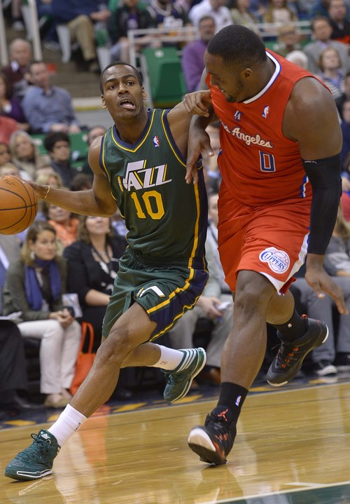 Leah Hogsten     The Salt Lake Tribune Utah Jazz guard Alec Burks (10) battles Los Angeles Clippers forward Glen Davis (0) as he drives the court. Utah Jazz lead the Los Angeles Clippers 51-43 at the half during their game, Friday, March, 14, 2014 at Energy Solutions Arena.