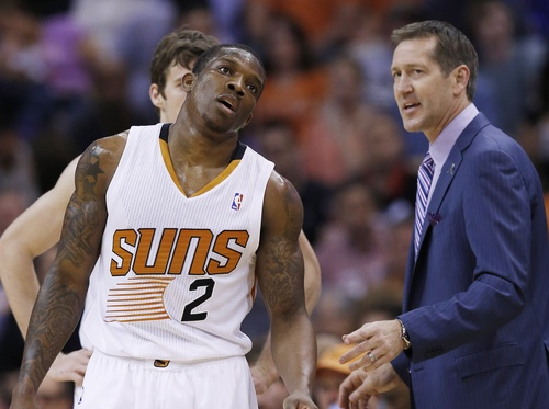 Phoenix Suns' Eric Bledsoe (2) and Goran Dragic, back, of Slovenia, talk with head coach Jeff Hornacek, right, during the second half of an NBA basketball game against the Cleveland Cavaliers, Wednesday, March 12, 2014, in Phoenix.  The Cavaliers defeated the Suns 110-101. (AP Photo/Ross D. Franklin)
