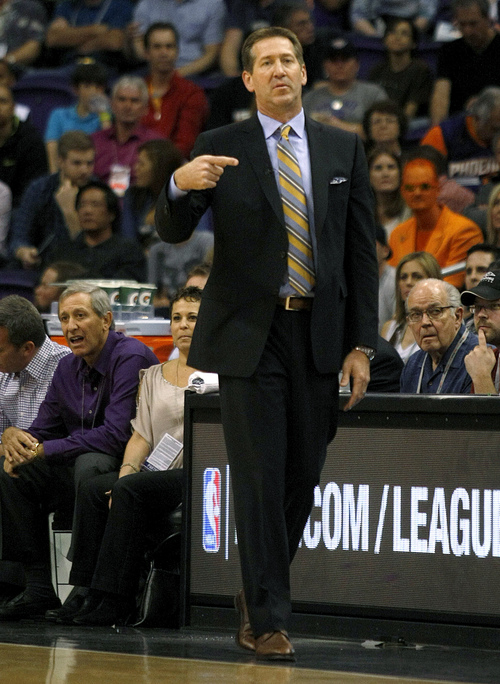 Phoenix Suns head coach Jeff Hornacek signals in a play in the first quarter during an NBA basketball game against the Houston Rockets, Sunday, Feb. 23, 2014, in Phoenix. (AP Photo/Rick Scuteri)