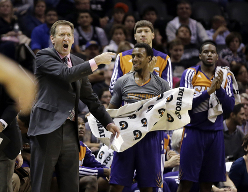 Phoenix Suns coach Jeff Hornacek, left, and players celebrate a basket against the San Antonio Spurs during the second half of an NBA basketball game Wednesday, Nov. 6, 2013, in San Antonio. San Antonio won 99-96. (AP Photo/Eric Gay)