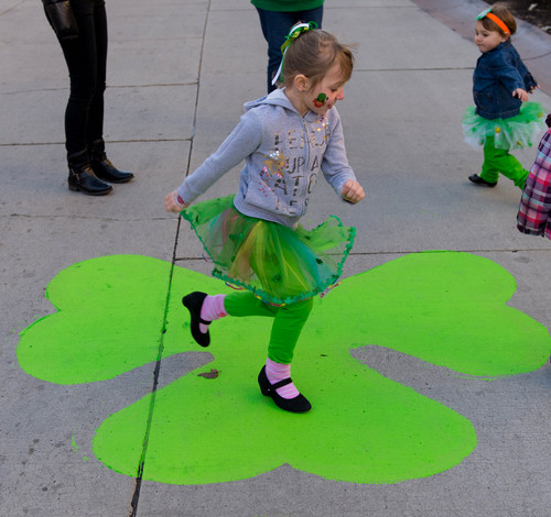 Trent Nelson  |  The Salt Lake Tribune Olivia Davies dances on a shamrock before the St. Patrick's Day Parade at The Gateway in Salt Lake City, Saturday, March 15, 2014.