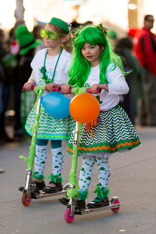 Trent Nelson  |  The Salt Lake Tribune Girls from Hilltop Christian School scoot by at the St. Patrick's Day Parade at The Gateway in Salt Lake City, Saturday, March 15, 2014.