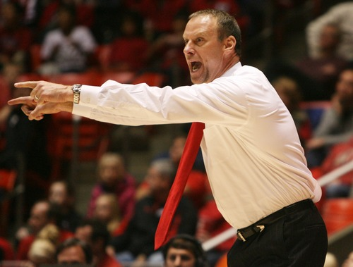 Kim Raff  |  The Salt Lake Tribune University of Utah head coach Larry Krystkowiak yells on the sideline during a game against Cal State Northridge at the Huntsman Center in Salt Lake City on December 21, 2012.