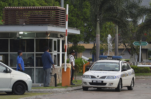 A police car comes out of a main gate of the missing Malaysia Airlines pilot Zaharie Ahmad Shah's house in Shah Alam, outside Kuala Lumpur, Malaysia, Saturday, March 15, 2014. Malaysian police have already said they are looking at the psychological state, the family life and connections of pilot Zaharie, 53, and co-pilot Fariq Abdul Hamid, 27. Both have been described as respectable, community-minded men. The Malaysian jetliner missing for more than a week had its communications deliberately disabled and its last signal came about 7 1/2 hours after takeoff, meaning it could have ended up as far as Kazakhstan or into the southern reaches of the Indian Ocean, Malaysian Prime Minister Najib Razak said Saturday. (AP Photo) MALAYSIA OUT