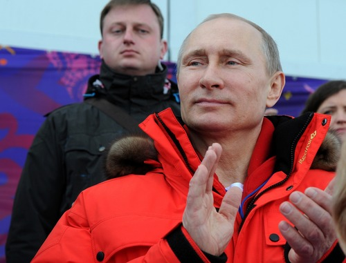 Russian President Vladimir Putin applauds while visiting the Laura biathlon and cross-country ski center in Krasnaya Polyana, Russia, Saturday, March 15, 2014. (AP Photo/RIA-Novosti, Mikhail Klimentyev, Presidential Press Service)